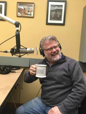Mr. Clark drinking coffee at WICN.